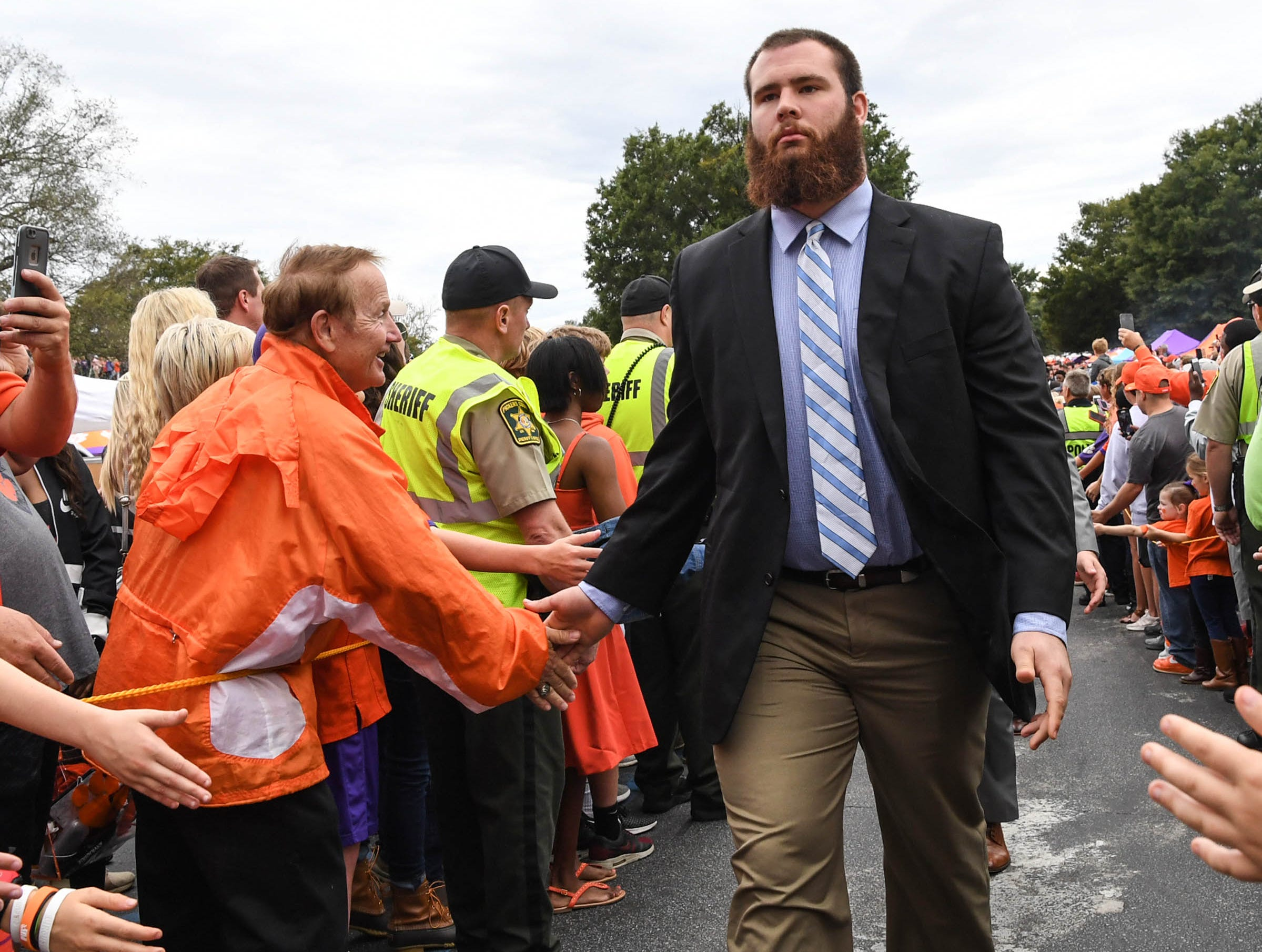 Clemson offensive lineman Sean Pollard (76) walks by fans during Tiger Walk before the game in Memorial Stadium on Saturday, October 20, 2018.