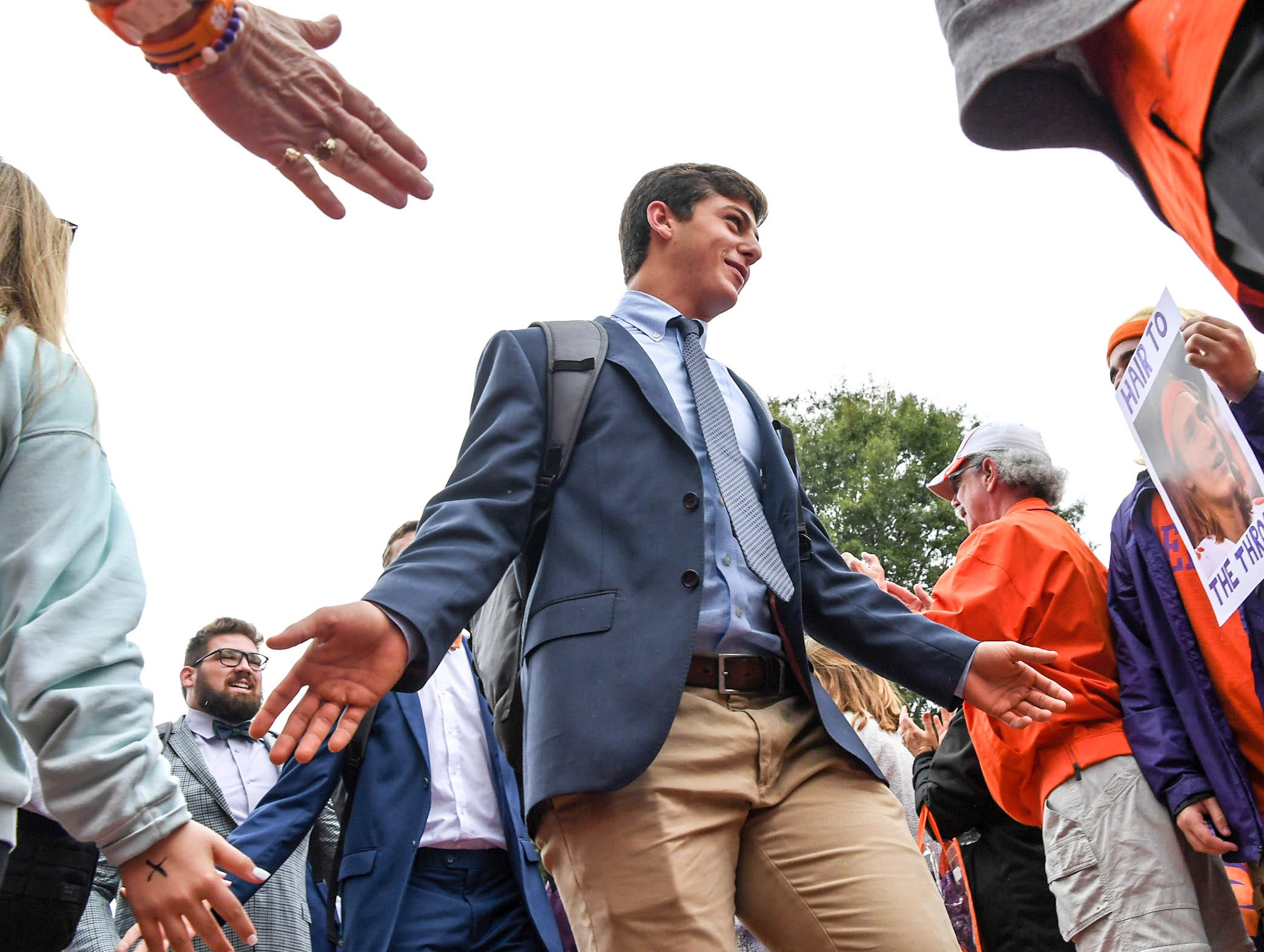Clemson wide receiver Drew Swinney (81) walks by fans during Tiger Walk before the game in Memorial Stadium on Saturday, October 20, 2018.
