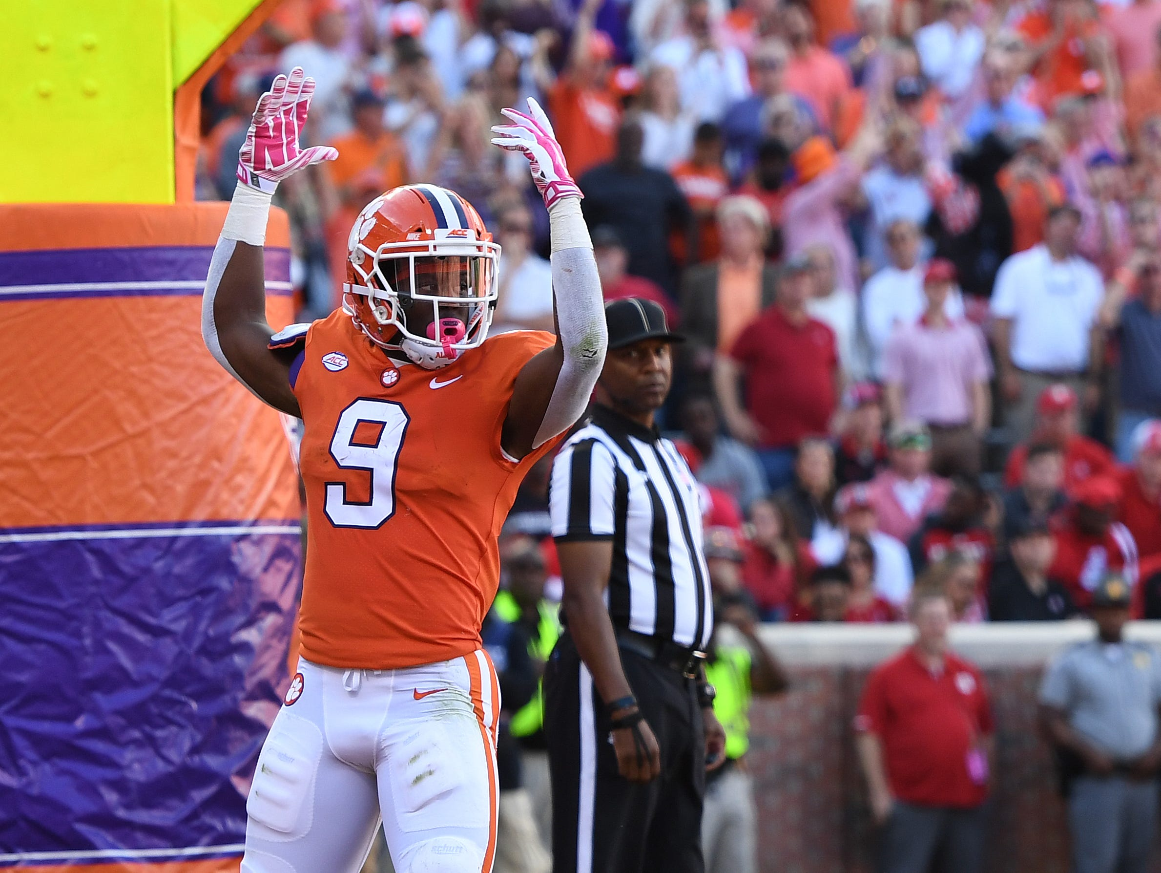 Clemson running back Travis Etienne (9) scores against NC State during the 2nd quarter Saturday, October 20, 2018 at Clemson's Memorial Stadium.