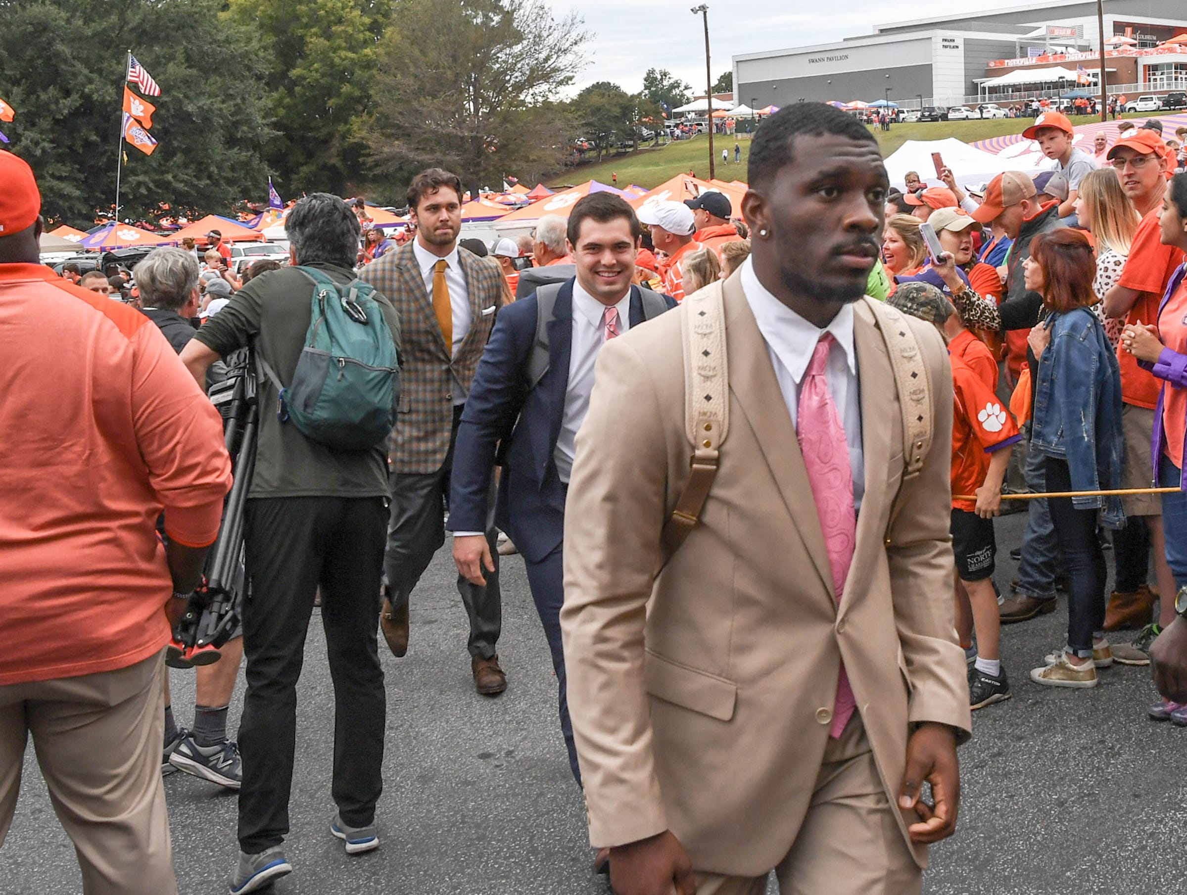 Clemson running back Tavien Feaster (28) walks by fans during Tiger Walk before the game in Memorial Stadium on Saturday, October 20, 2018.