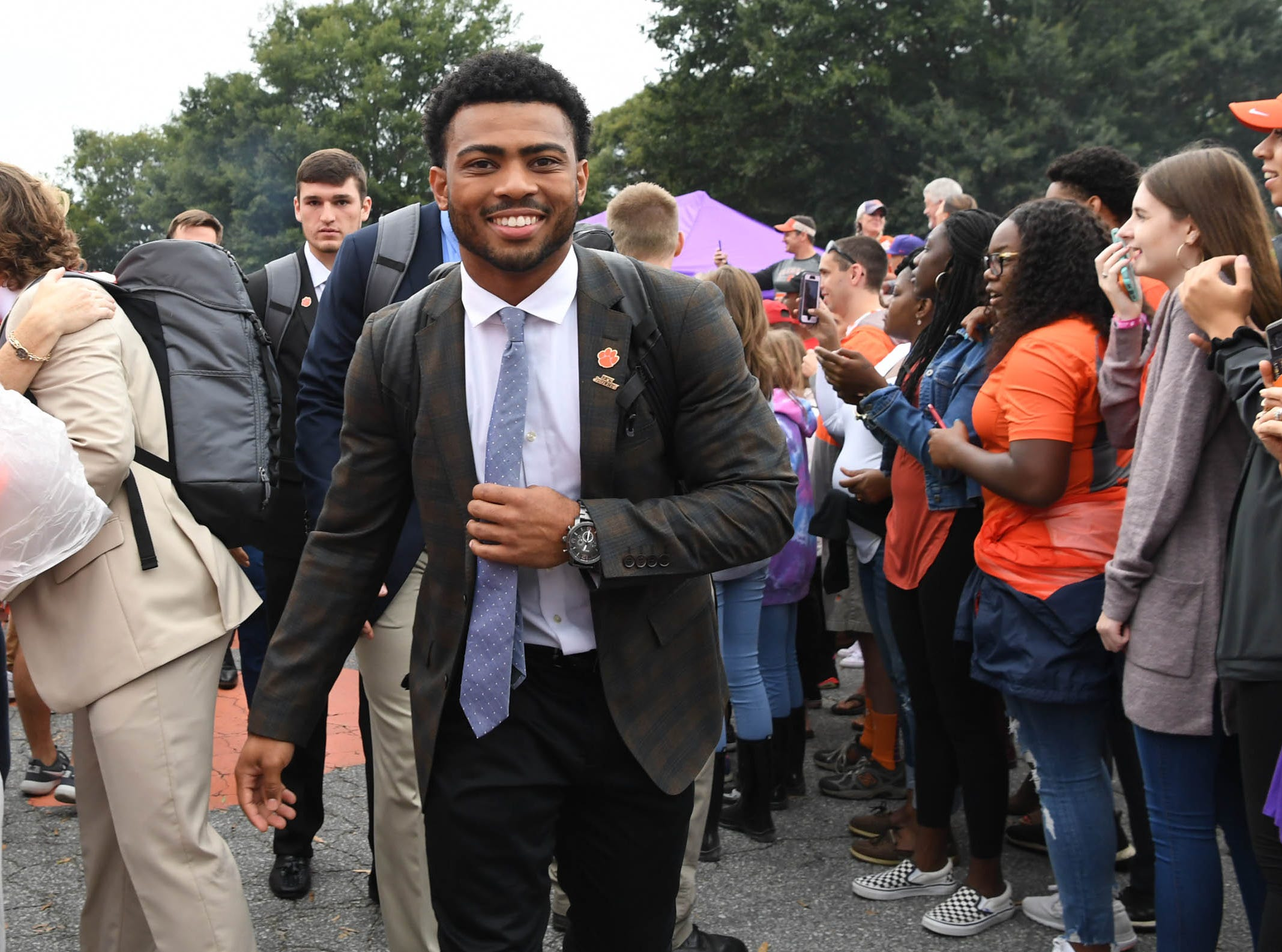 Clemson running back Darien Rencher (21) walks by fans during Tiger Walk before the game in Memorial Stadium on Saturday, October 20, 2018.