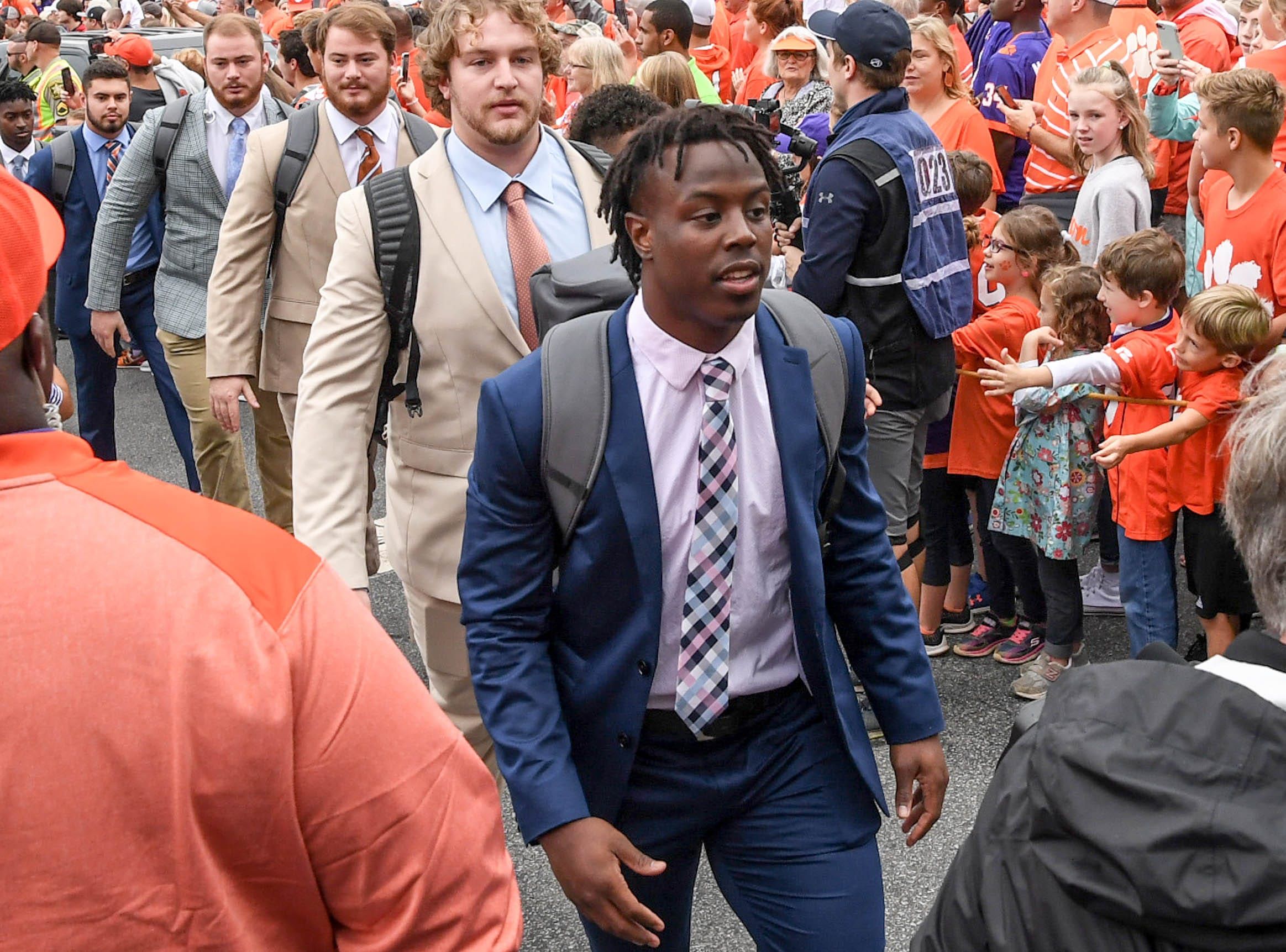 Clemson running back Travis Etienne (9) walks by fans during Tiger Walk before the game in Memorial Stadium on Saturday, October 20, 2018.