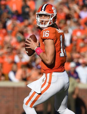 Clemson quarterback Trevor Lawrence (16) looks to pass against NC State during the 2nd quarter Saturday, October 20, 2018 at Clemson's Memorial Stadium.