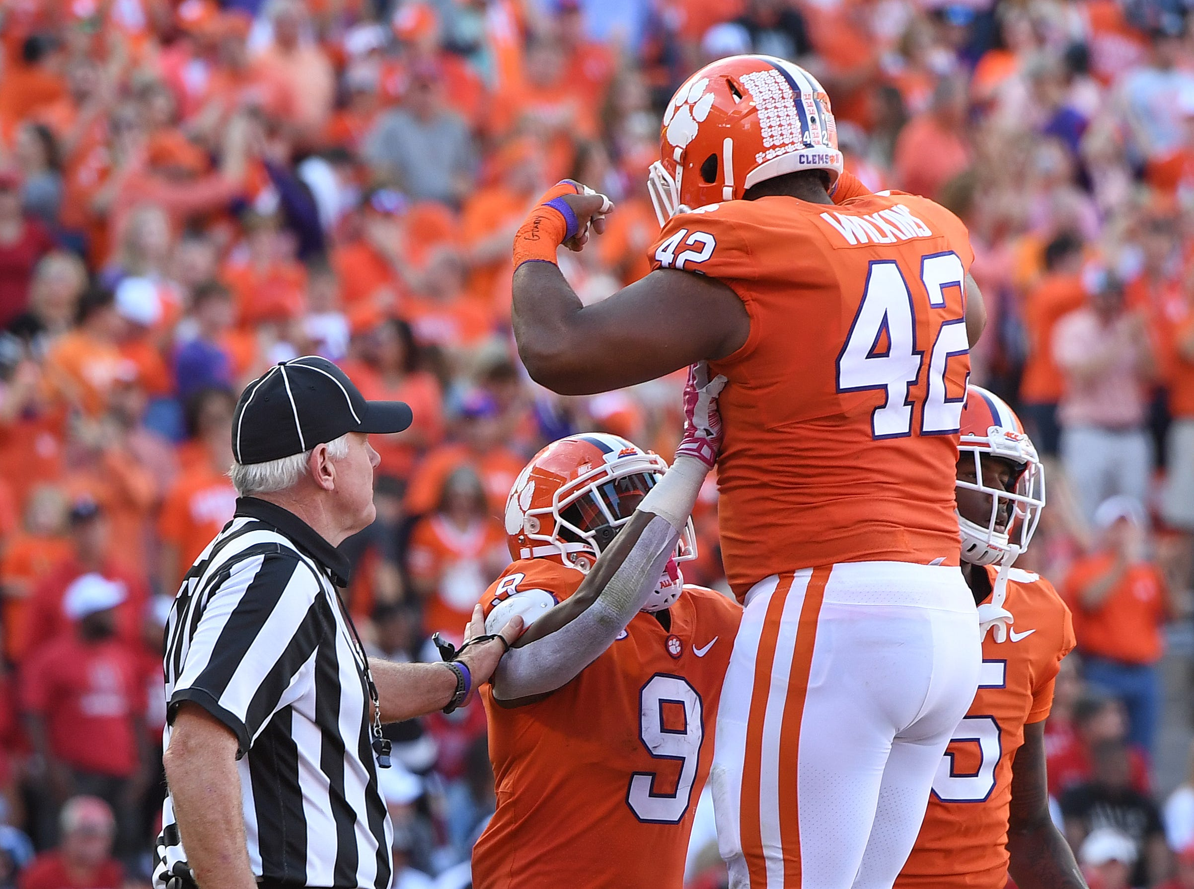 Clemson running back Travis Etienne (9) celebrates with defensive lineman Christian Wilkins (42) after scoring against NC State during the 2nd quarter Saturday, October 20, 2018 at Clemson's Memorial Stadium.