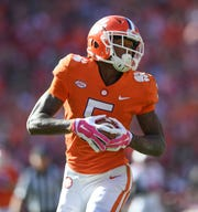 Clemson wide receiver Tee Higgins (5) catches a TD against NC State during the 1st quarter Saturday, October 20, 2018 at Clemson's Memorial Stadium.