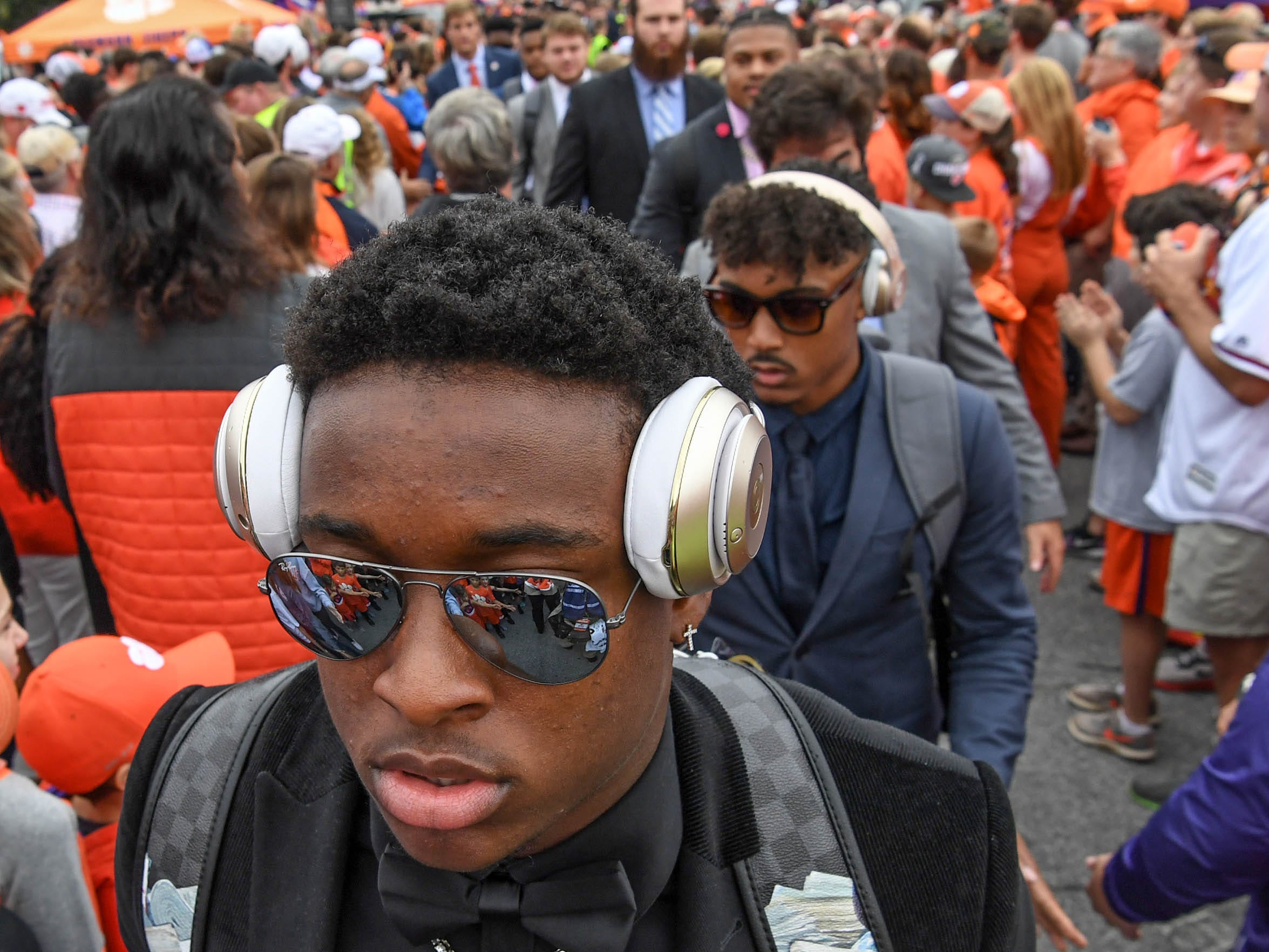 Clemson defensive back K'Von Wallace (12) walks by fans during Tiger Walk before the game in Memorial Stadium on Saturday, October 20, 2018.