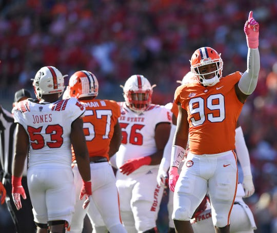 Clemson defensive lineman Clelin Ferrell (99) reacts after stoping NC State running back Ricky Person Jr. (20).