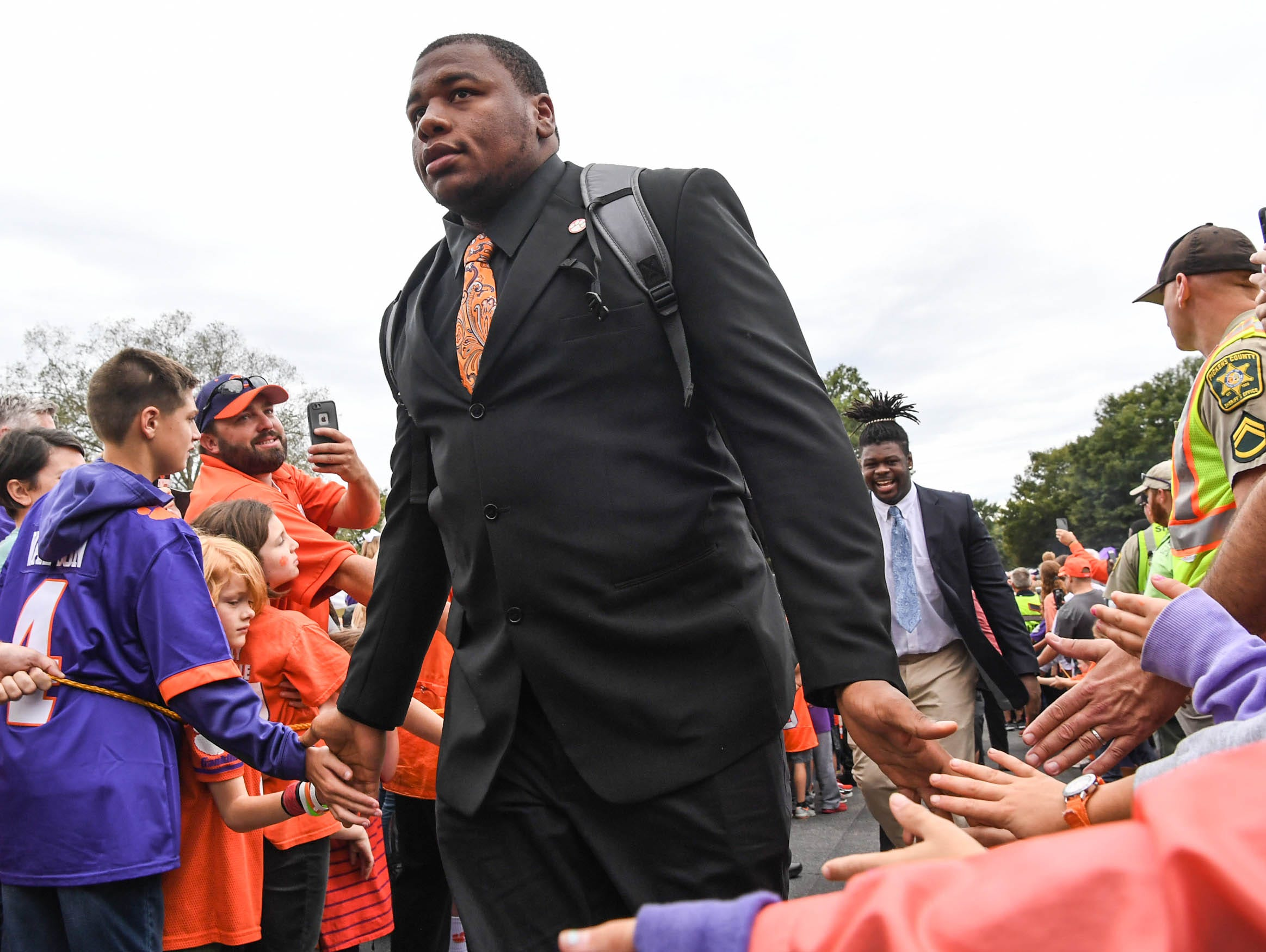 Clemson defensive lineman Dexter Lawrence (90) walks by fans during Tiger Walk before the game in Memorial Stadium on Saturday, October 20, 2018.