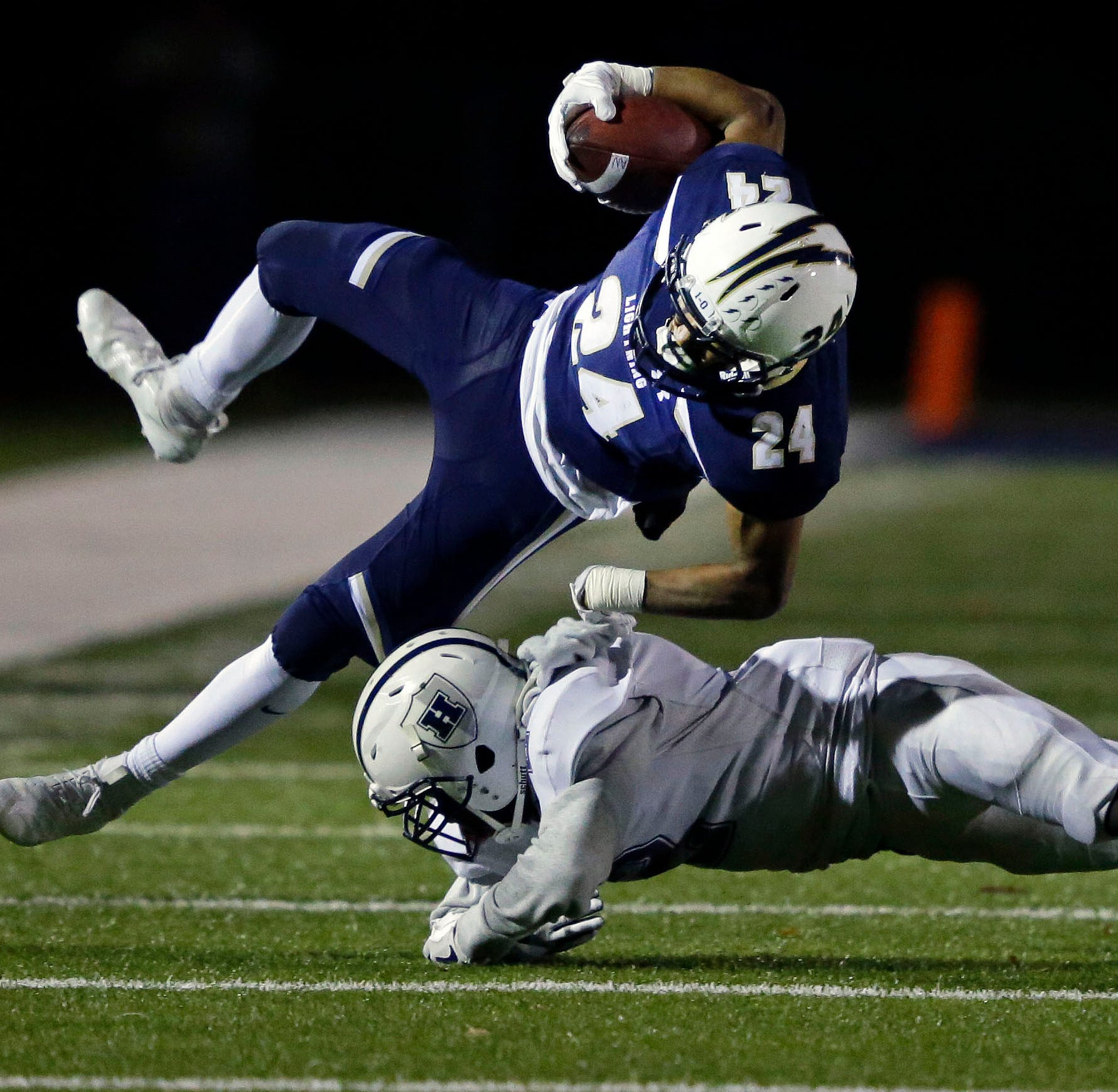 High school football: Appleton North rolls over Hudson for Division 1 playoff victory
