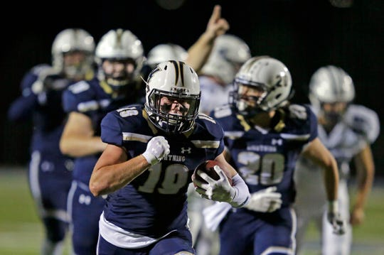 Appleton North's Ryan Balck heads for the end zone against Hudson in a WIAA Division 1 playoff game at Paul Engen Field on Friday.