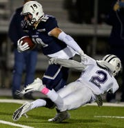 Ryan Balck of Appleton North heads for a touchdown as he breaks away from Jakes Asembo of Hudson on Friday.