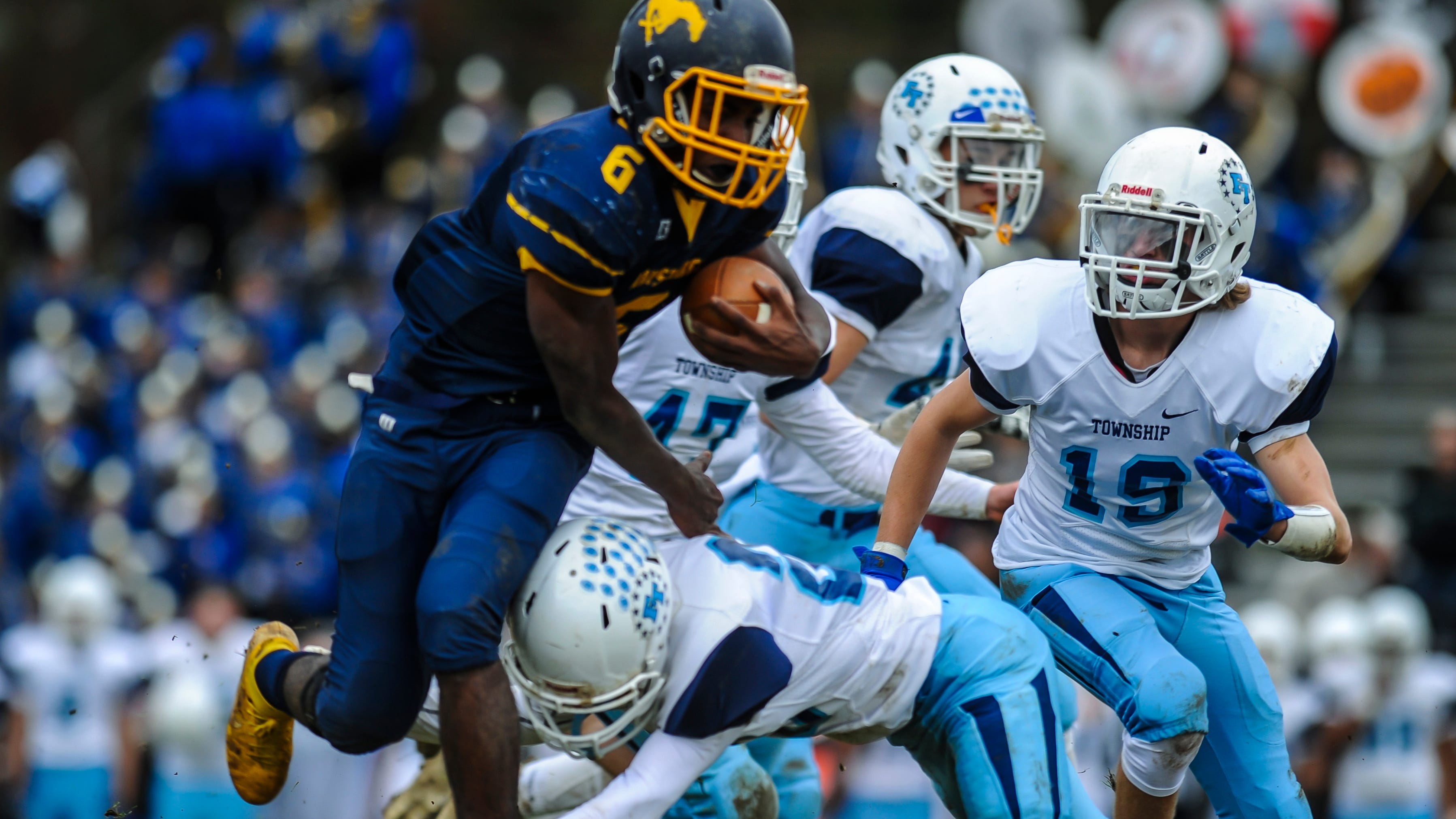 Dontrell Alston of Marlborro is upended by Ronald Veluya of Freehold Township in a game in Marlboro on Oct. 20, 2018.