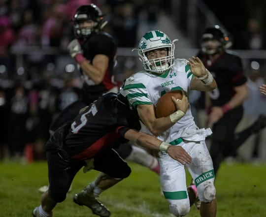 Brick's Anthony Prato looks for running room during first half action. Brick Football defeats Jackson Memorial in Jackson, NJ on October 19, 2018.