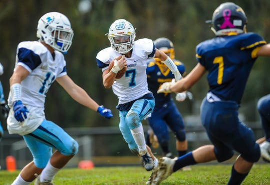 Freehold Township running back Gaven Ferraro breaks free for extra yards in a game against Marlboro on Oct. 20, 2018.
