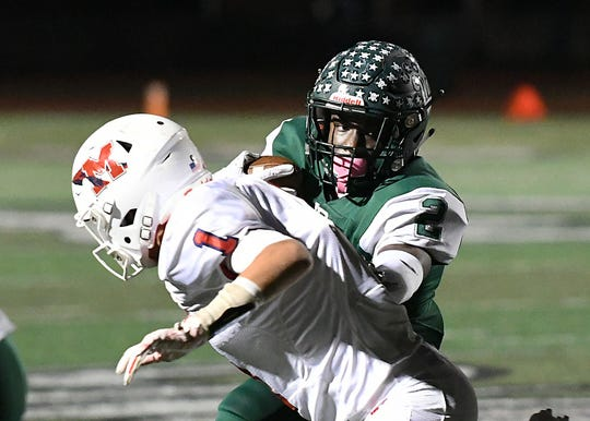 Long Branch's (2) Jermaine Corbett moves around Manalapan's Nick Marzo as Manalapan Football takes on Long Branch on 10/19/2018