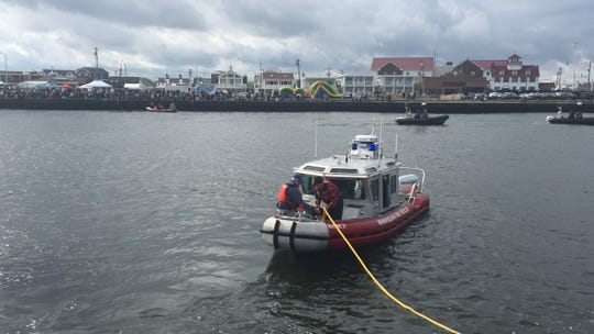 A Manasquan Fire Rescue boat prepares to take a rope across the Manasquan Inlet in the tug-of-war with Point Pleasant Beach, Oct. 20, 2018.