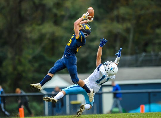Vinny Spitalleri of Marlborro nearly makes an interception on a pass intended for Freehold Township wide receiver Jacob Cancela in a game in Marlboro on Oct. 20, 2018.