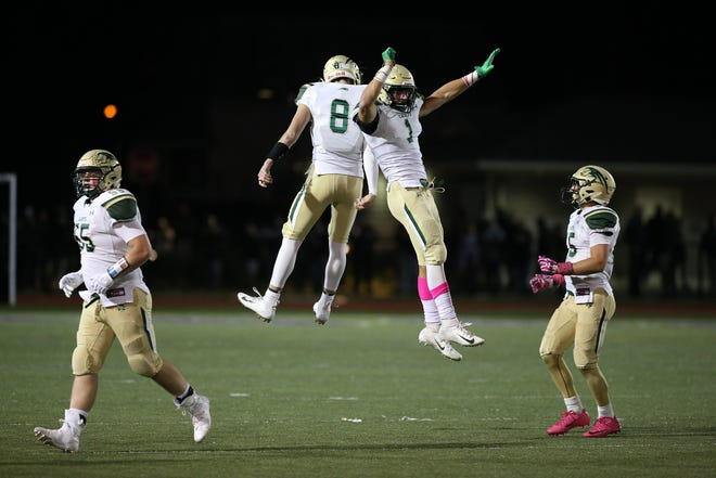 RBC celebrates an interception during the second half of the Red Bank Catholic and Rumson-Fair Haven football game at Rumon-Fair Haven High School in Rumson, NJ Friday, October 19, 2018.