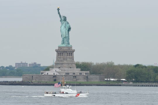 "The Coast Guard Cutter ""Shrike,"" an 87-foot patrol boat based in Bayonne, passes the Statue of Liberty in this 2017 file photo from the U.S. Coast Guard."