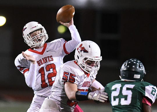 Manalapan QB Sean Kehley looks to pass as Manalapan Football takes on Long Branch on 10/19/2018