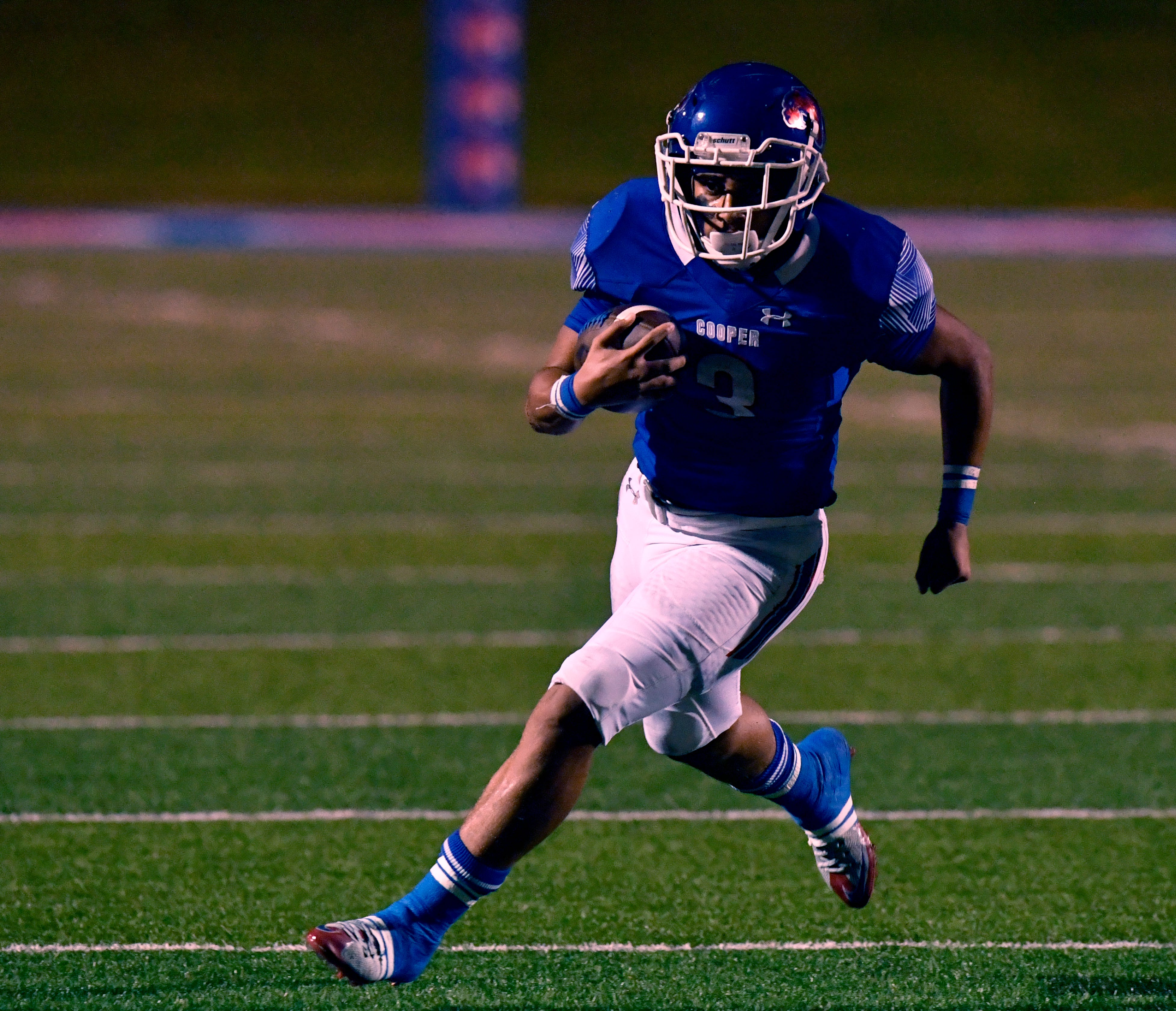 Cougars running back Noah Garcia carries the ball downfield during Cooper High's game against Caprock High Friday Oct. 19, 2018. Final score was 28-12, Cooper.