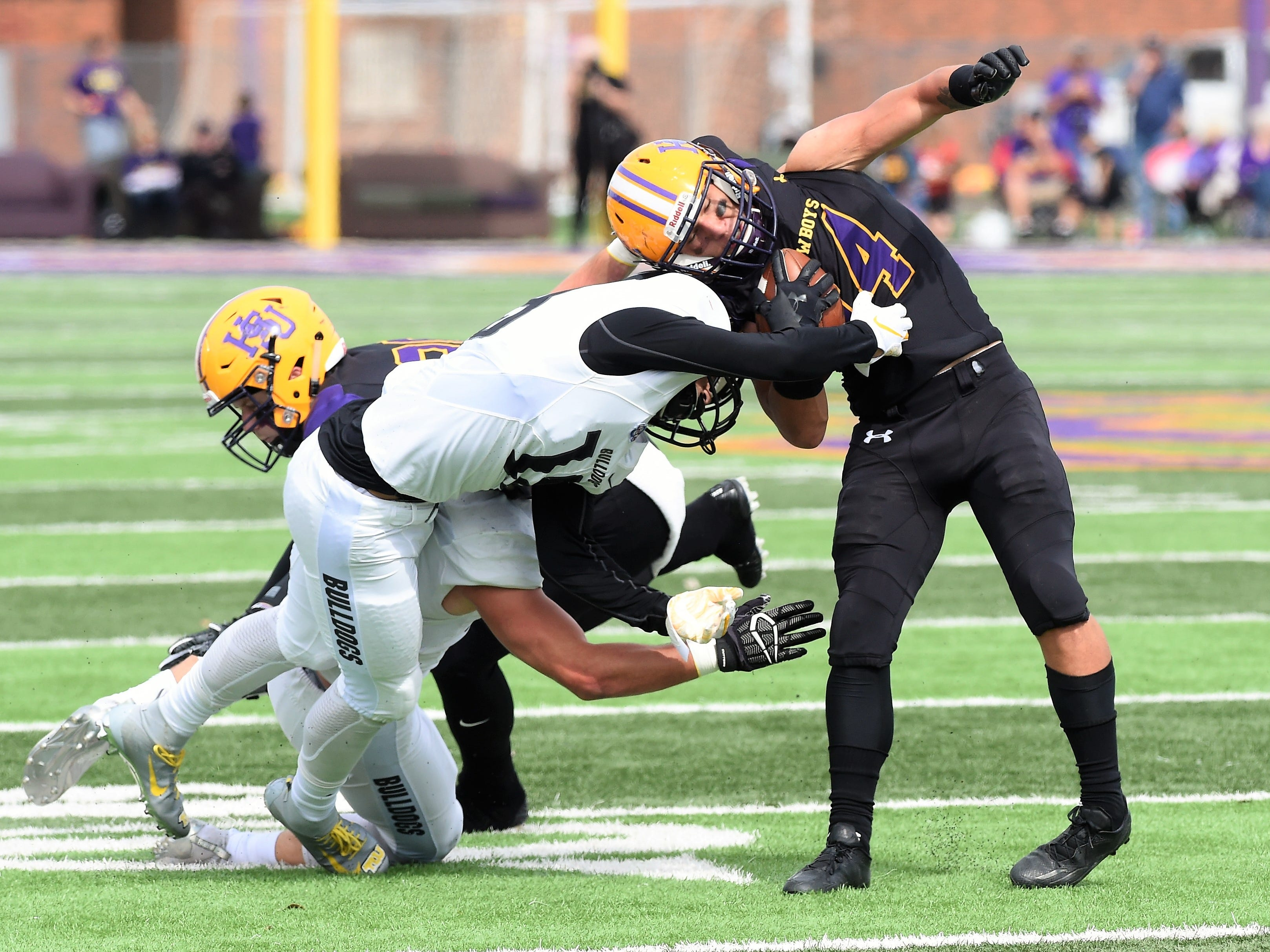 Hardin-Simmons slotback Bryson Hammonds (14) slips away from a tackle for more yards against Texas Lutheran at Shelton Stadium on Saturday, Oct. 20, 2018.