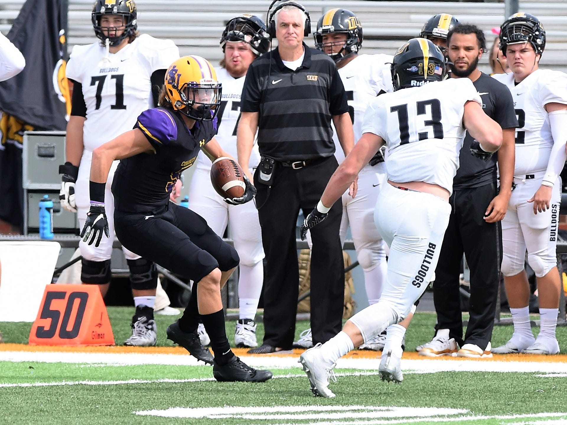 Hardin-Simmons receiver Reese Childress (5) makes a move after a catch against Texas Lutheran at Shelton Stadium on Saturday, Oct. 20, 2018.
