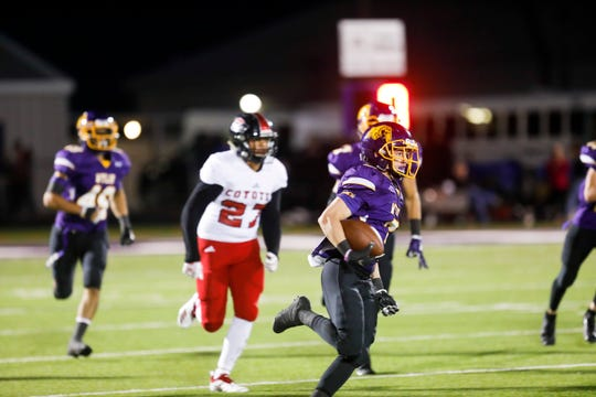 Wylie's Jaden Speegle (3) runs back a Coyote kickoff to score Wylie's first touchdown of the night early in the first quarter at Bulldog Stadium. The Bulldogs scored 22 first-half points but lost 64-22.