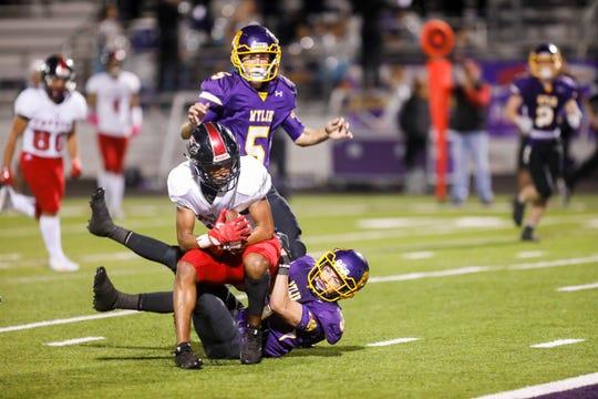 Wylie defensive back Jaden Speegle (3) pulls down Coyote wide receiver Tre Mckenzie (3) Friday during their district game at Wylie High School. WFHS won 64-22.