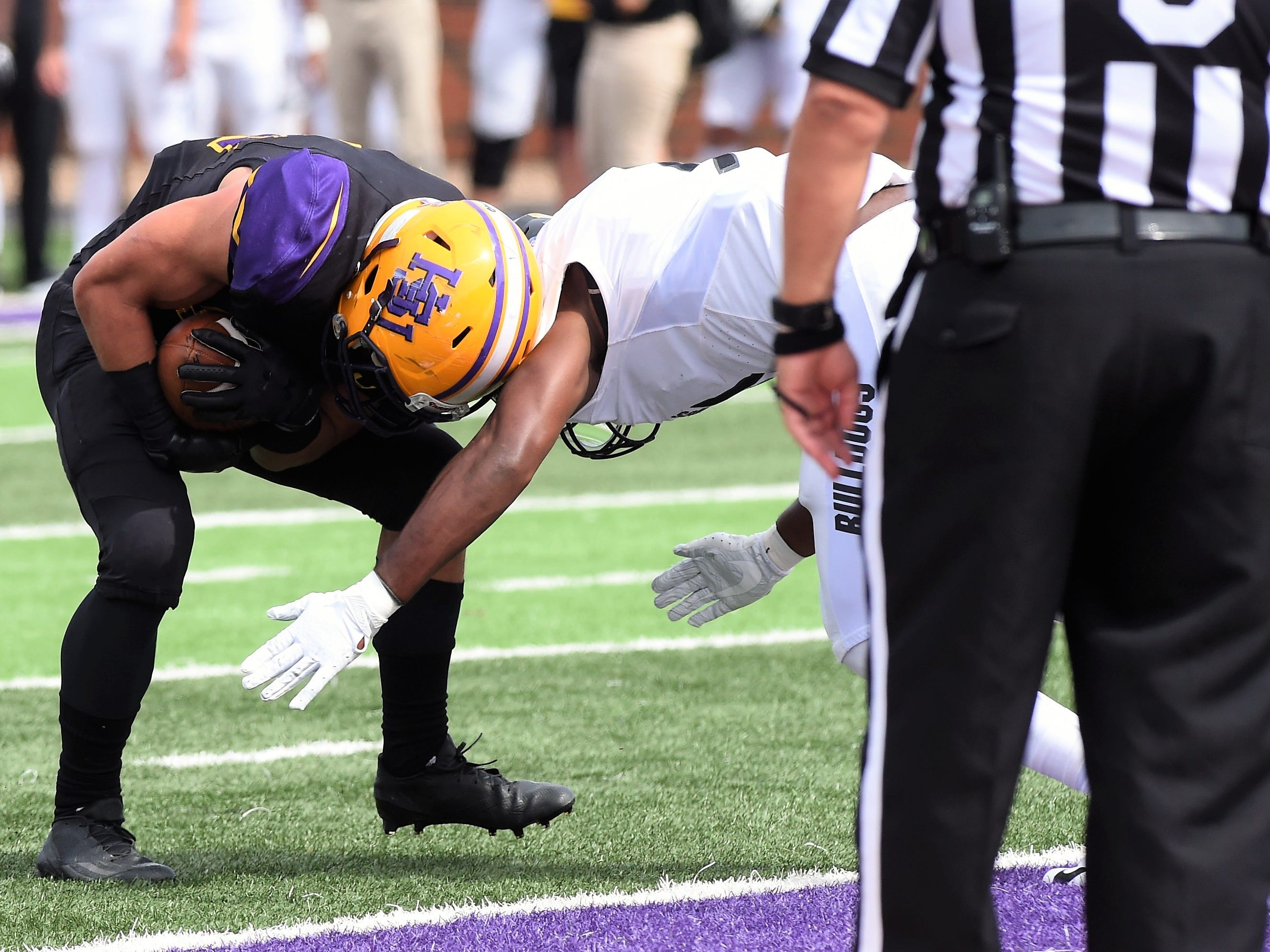 Hardin-Simmons slotback Bryson Hammonds (14) pushes his way into an end zone for a touchdown against Texas Lutheran at Shelton Stadium on Saturday, Oct. 20, 2018.