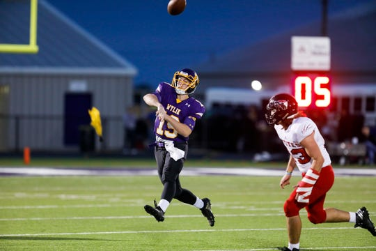 Wylie quarterback Harrison Atwood  (19) throws a pass while on the move Friday during a district game against the Wichita Falls High School Coyotes at Bulldog Stadium. WF won, 64-22.