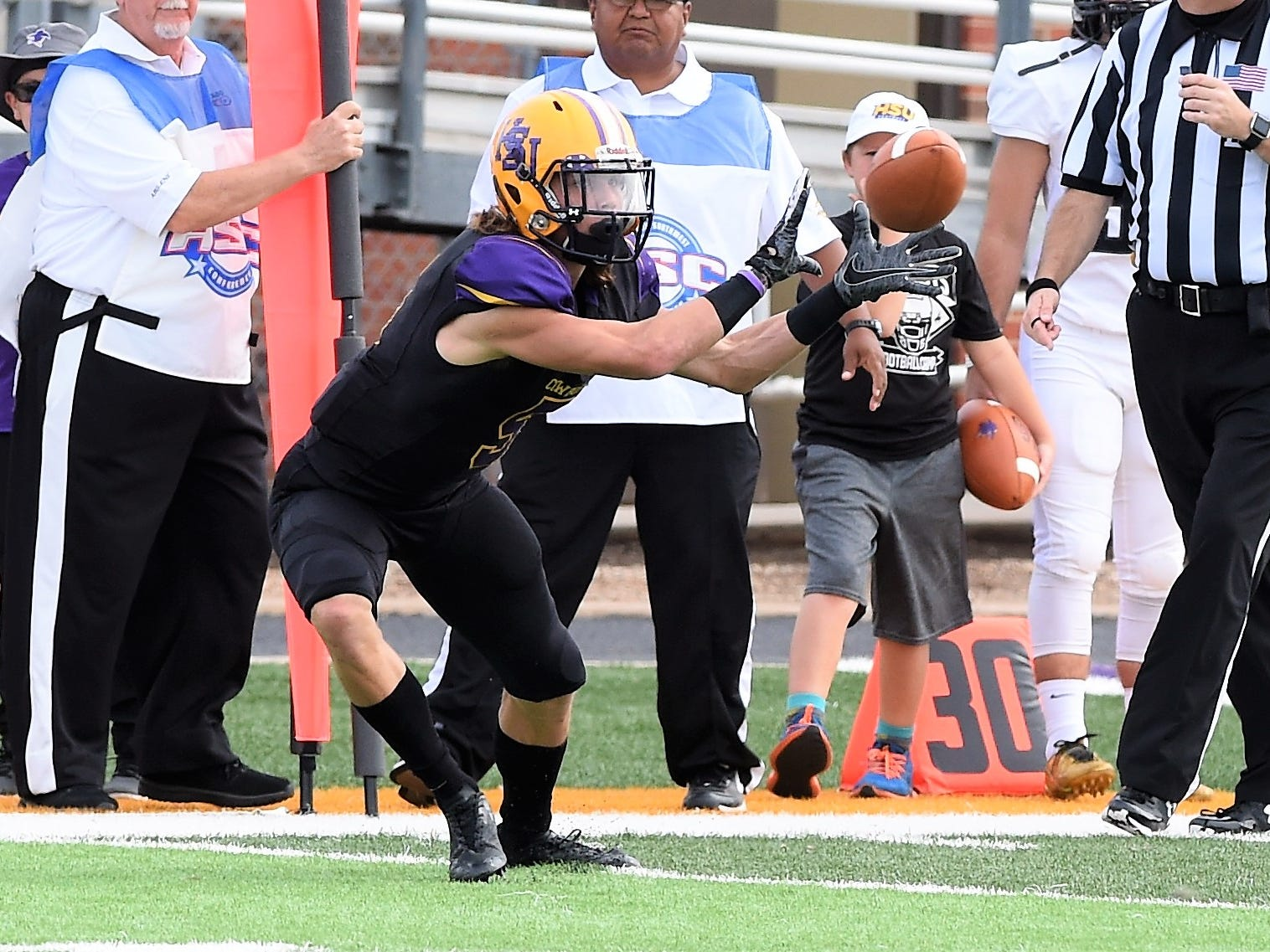 Hardin-Simmons receiver Reese Childress (5) looks in a pass against Texas Lutheran at Shelton Stadium on Saturday, Oct. 20, 2018.