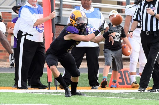 Hardin-Simmons receiver Reese Childress (5) looks in a pass against Texas Lutheran at Shelton Stadium on Saturday.