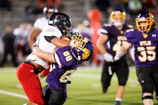 Wichita Falls High School's Isiah Cherry fights for yardage Friday night in a 64-22 victory over Abilene Wylie.