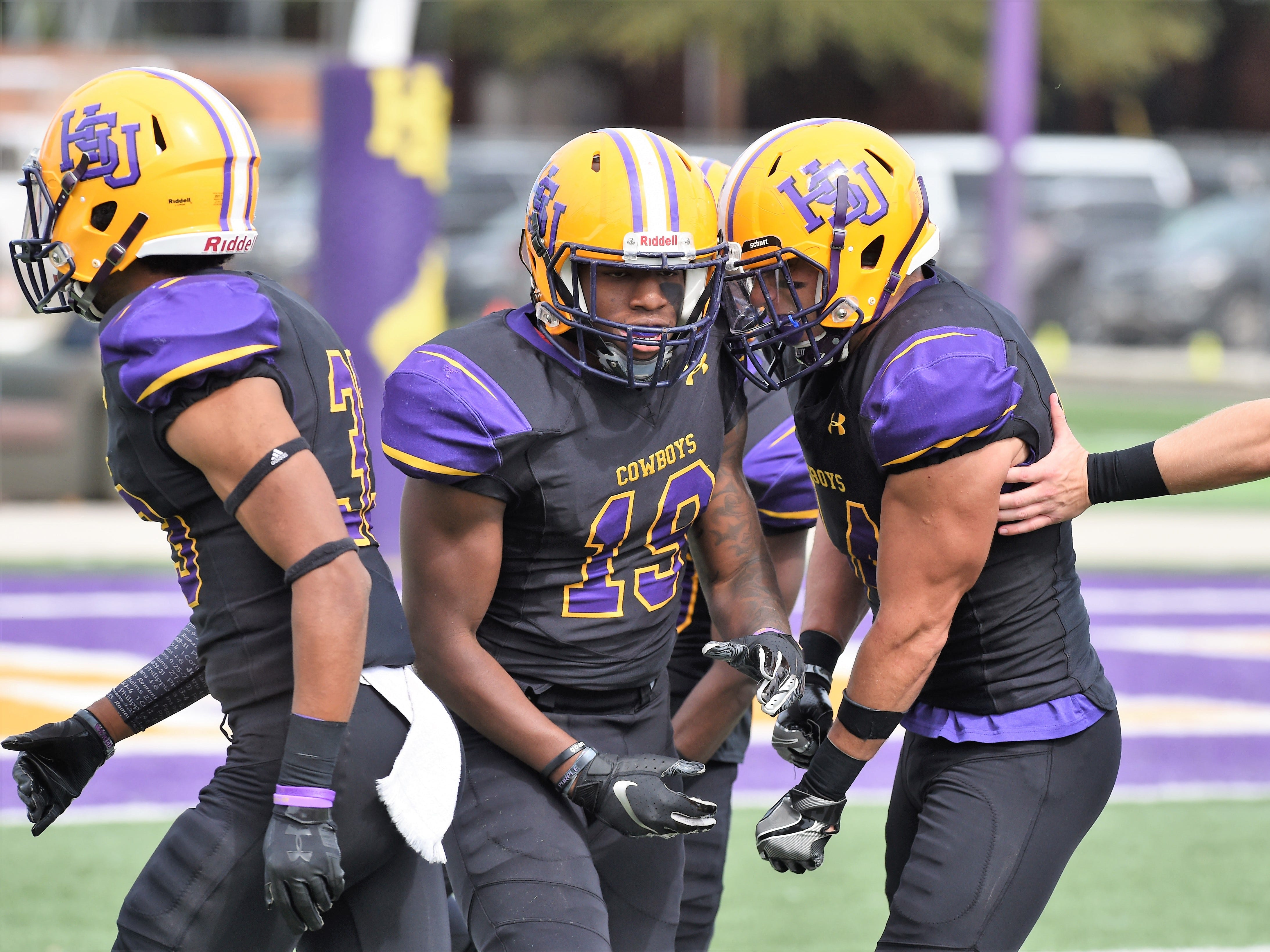 Hardin-Simmons' Kelton McGee (19) is congratulated after a special teams tackle against Texas Lutheran at Shelton Stadium on Saturday, Oct. 20, 2018.