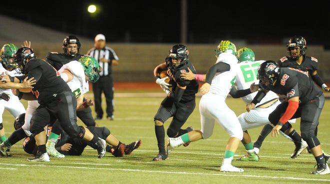 Colorado City running back Bubba Williams (7) runs through a hole in the first quarter of the team's game against Idalou at Wolf Stadium on Friday. The Wolves won 21-7.