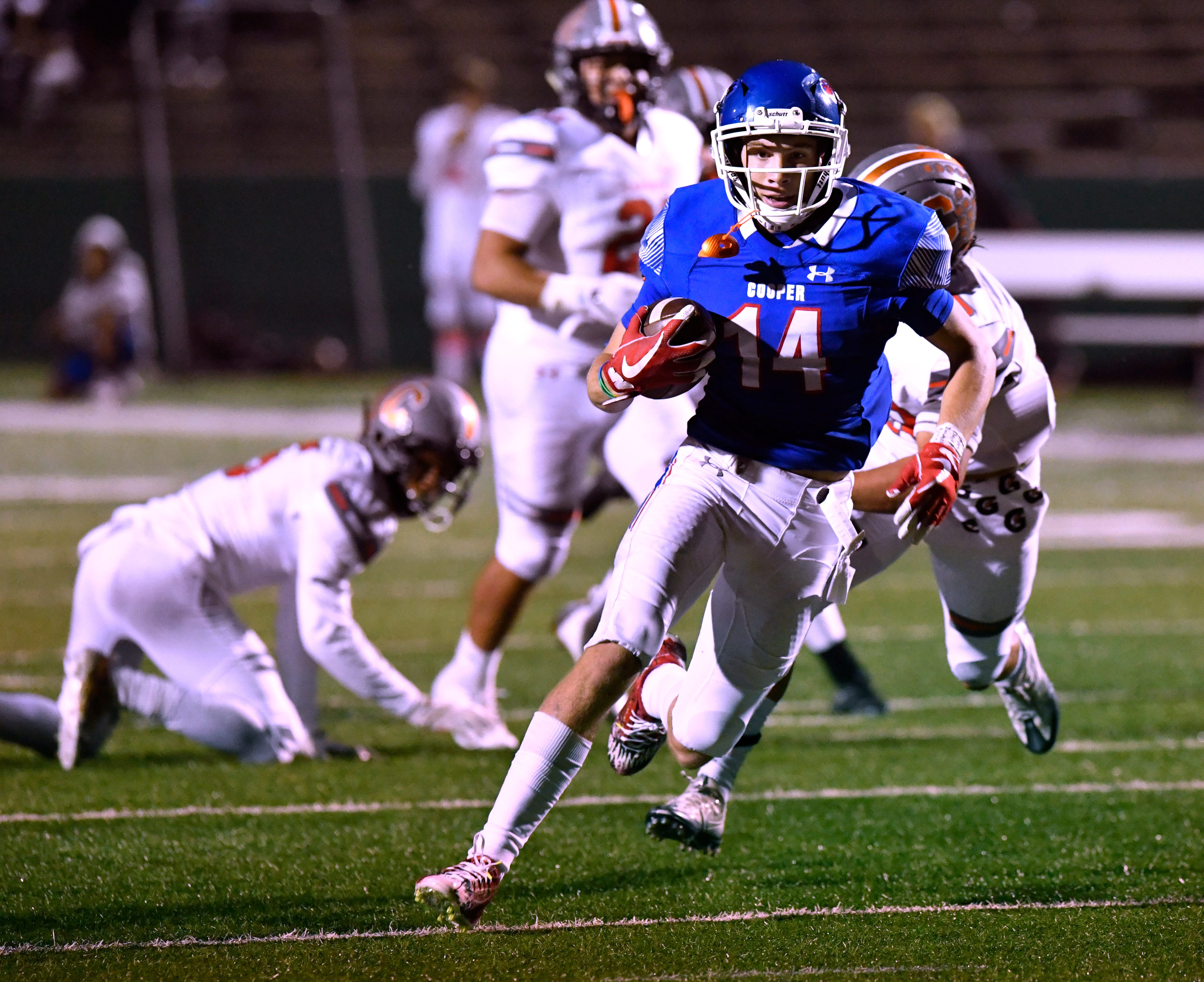 Cooper High wide receiver Mason Reynolds carries the ball during Friday's game against Caprock High Oct. 19, 2018. Final score was 28-12, Cooper.