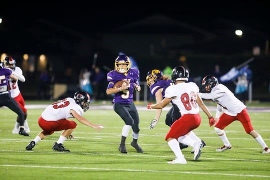 Wylie wide receiver Calvin Tiner (5) is surrounded by a trio of Coyotes defenders Friday night.