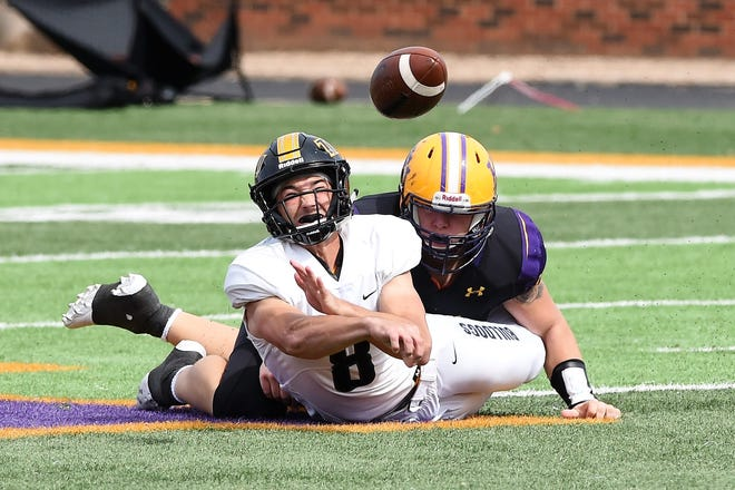 Hardin-Simmons defensive lineman Hunter Creasey (96) brings down Texas Lutheran quarterback Kyle Grona (8) before he could throw the ball at Shelton Stadium on Saturday, Oct. 20, 2018.
