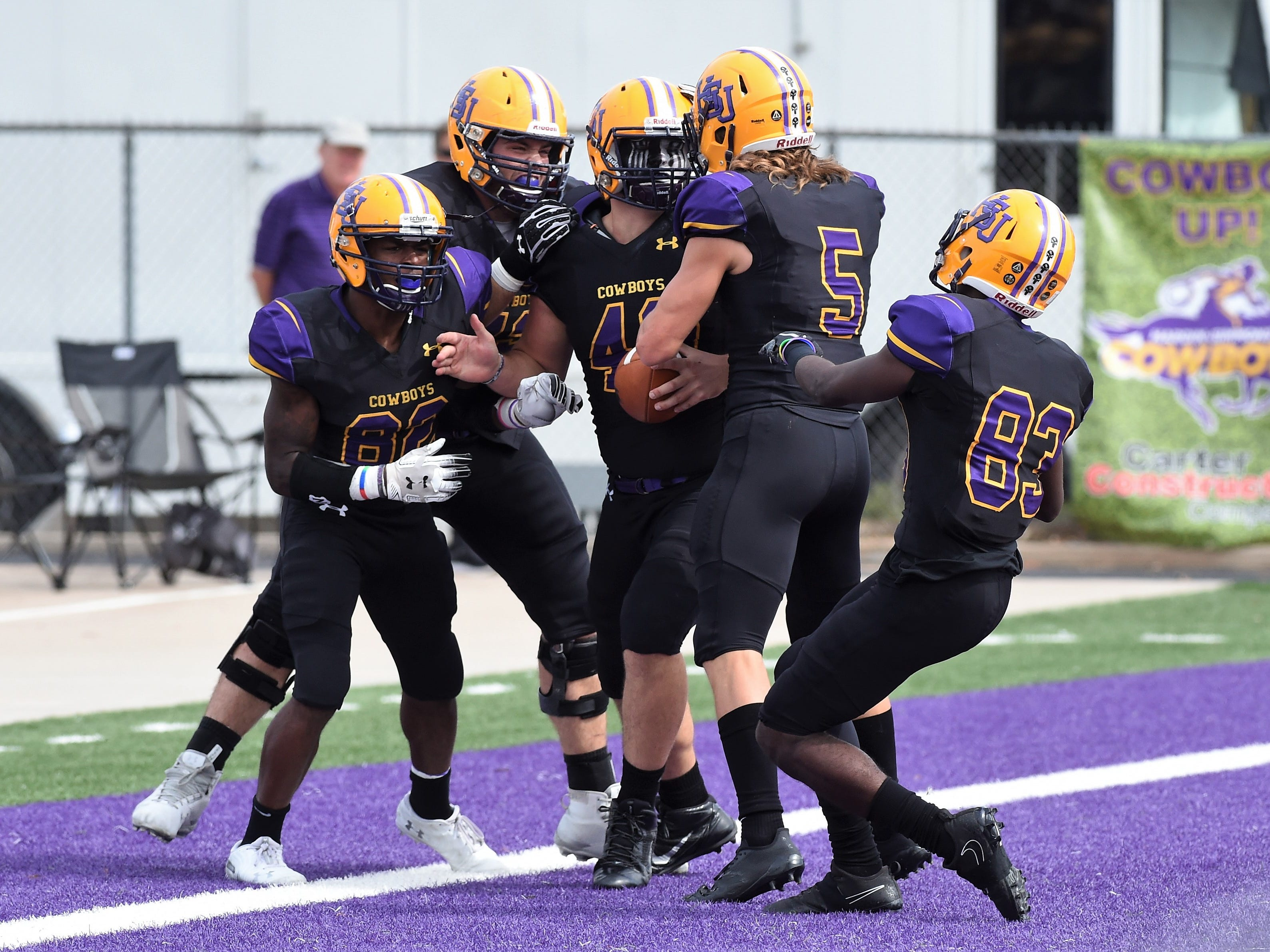 Hardin-Simmons tight end Hayden Day (48) is congratulated in the end zone after scoring against Texas Lutheran at Shelton Stadium on Saturday, Oct. 20, 2018.