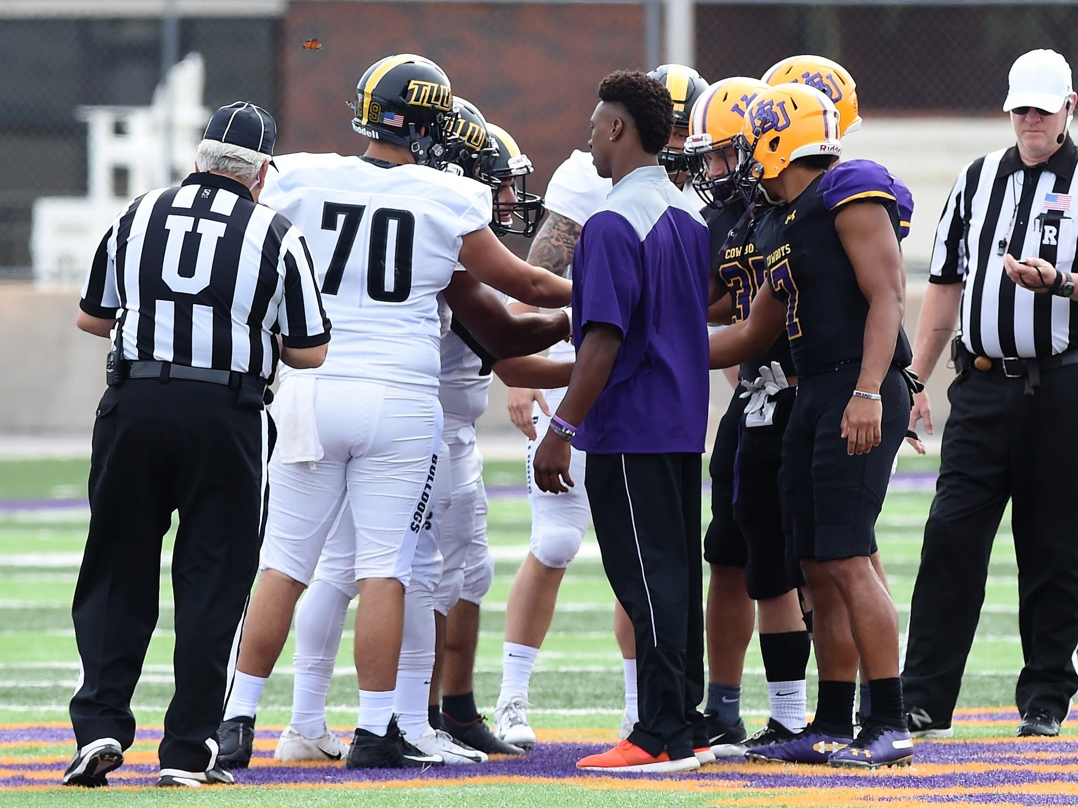 The Hardin-Simmons captains meet at midfield for the coin toss before facing Texas Lutheran at Shelton Stadium on Saturday, Oct. 20, 2018.