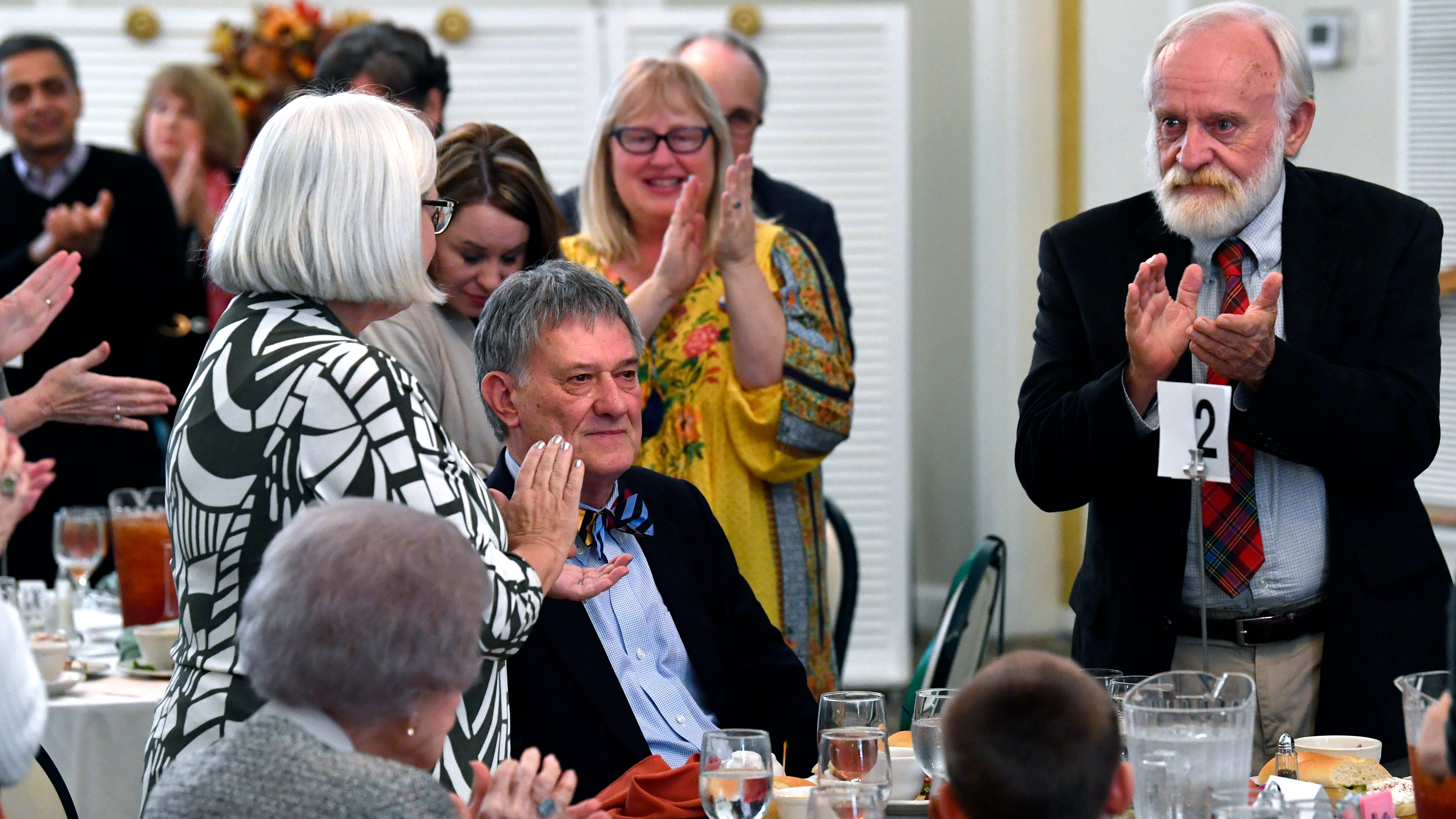 Colleagues and friends applaud Glenn Dromgoole after he accepted the A.C. Green Award during the Boots & Books Luncheon Saturday Oct. 20, 2018 at the Abilene Woman's Club. The award is presented to distinguished Texas authors by the West Texas Book Festival, of which Dromgoole is a past chair.