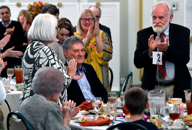 Colleagues and friends applaud Glenn Dromgoole after he accepted the A.C. Greene Award during the Boots & Books Luncheon Saturday at the Abilene Woman's Club. The award is presented to distinguished Texas authors by the West Texas Book Festival, of which Dromgoole is a past chairman.