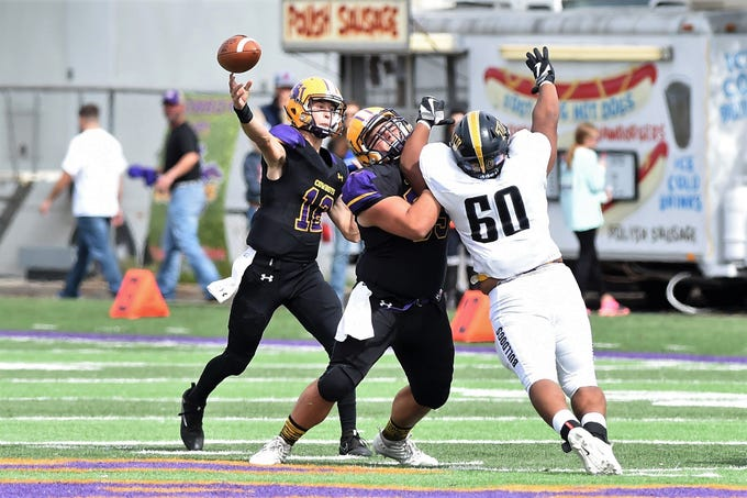 Hardin-Simmons quarterback Ty Hooper (12) lets a pass go against Texas Lutheran at Shelton Stadium on Saturday, Oct. 20, 2018.