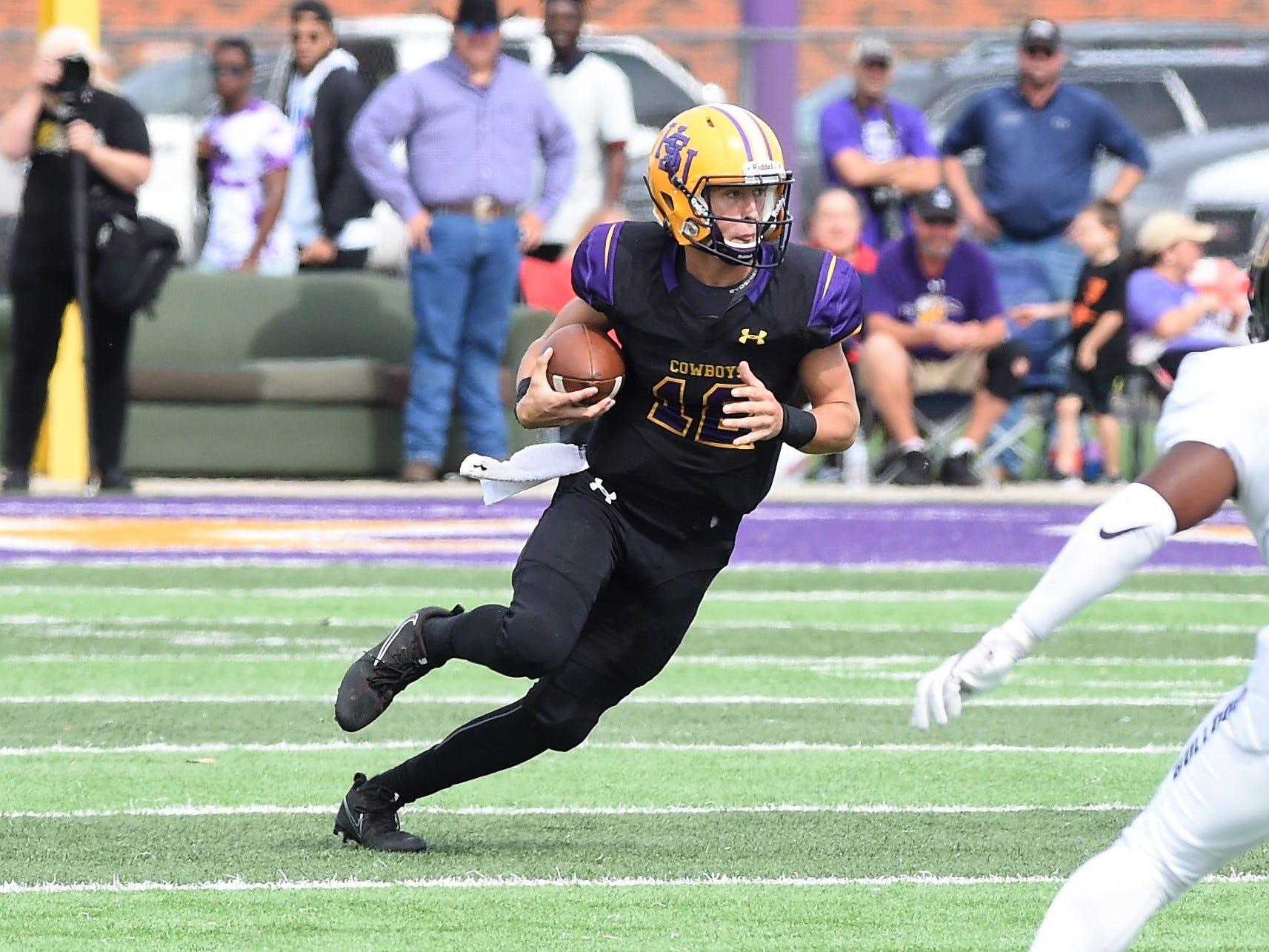 Hardin-Simmons quarterback Ty Hooper (12) scrambles for yards against Texas Lutheran at Shelton Stadium on Saturday, Oct. 20, 2018.