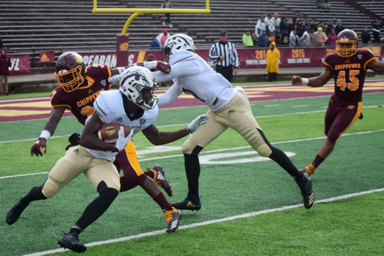 Western Michigan's Jayden Reed (87) returns a punt against Central Michigan's Sean Bunting during an NCAA college football game, Saturday, Oct. 20, 2018, in Mount Pleasant, Mich.