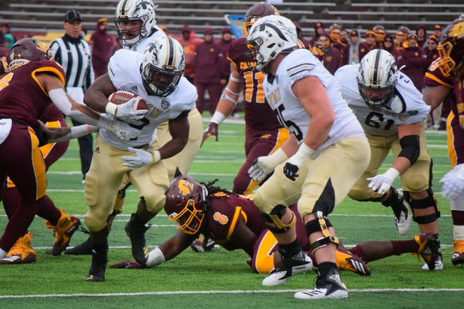 Western Michigan running back Jamauri Bogan (32) breaks through the tackle of Central Michigan's Sean Bunting (8) during an NCAA college football game, Saturday, Oct. 20, 2018, in Mount Pleasant, Mich.