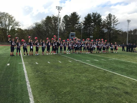 Chenango Forks players salute their followers postgame.