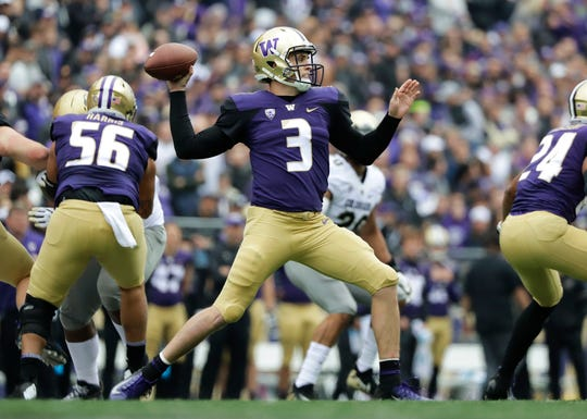 Washington quarterback Jake Browning rifles a pass against Colorado during the first half.