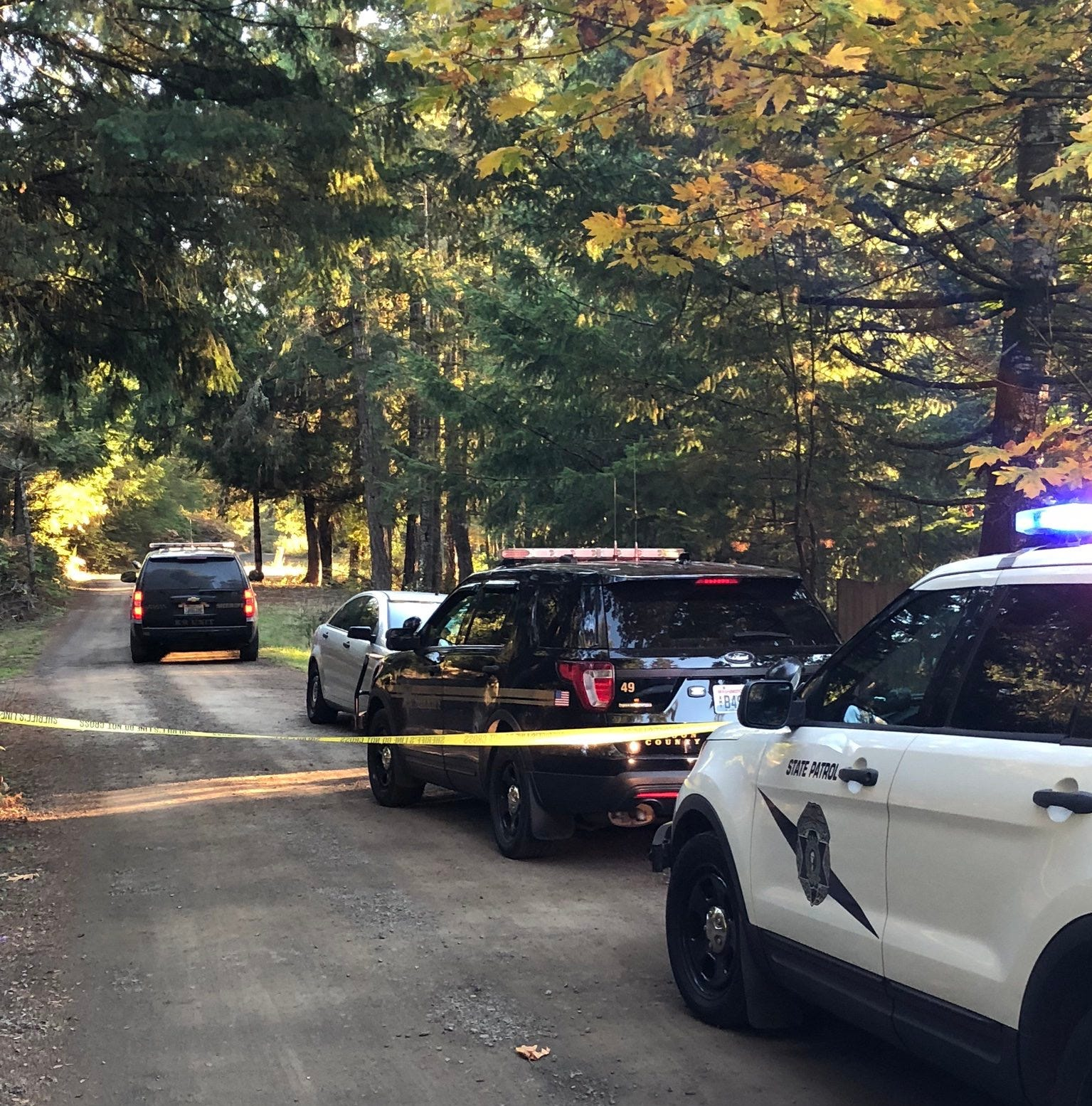 Detectives investigate two deaths in Mason County on Friday.